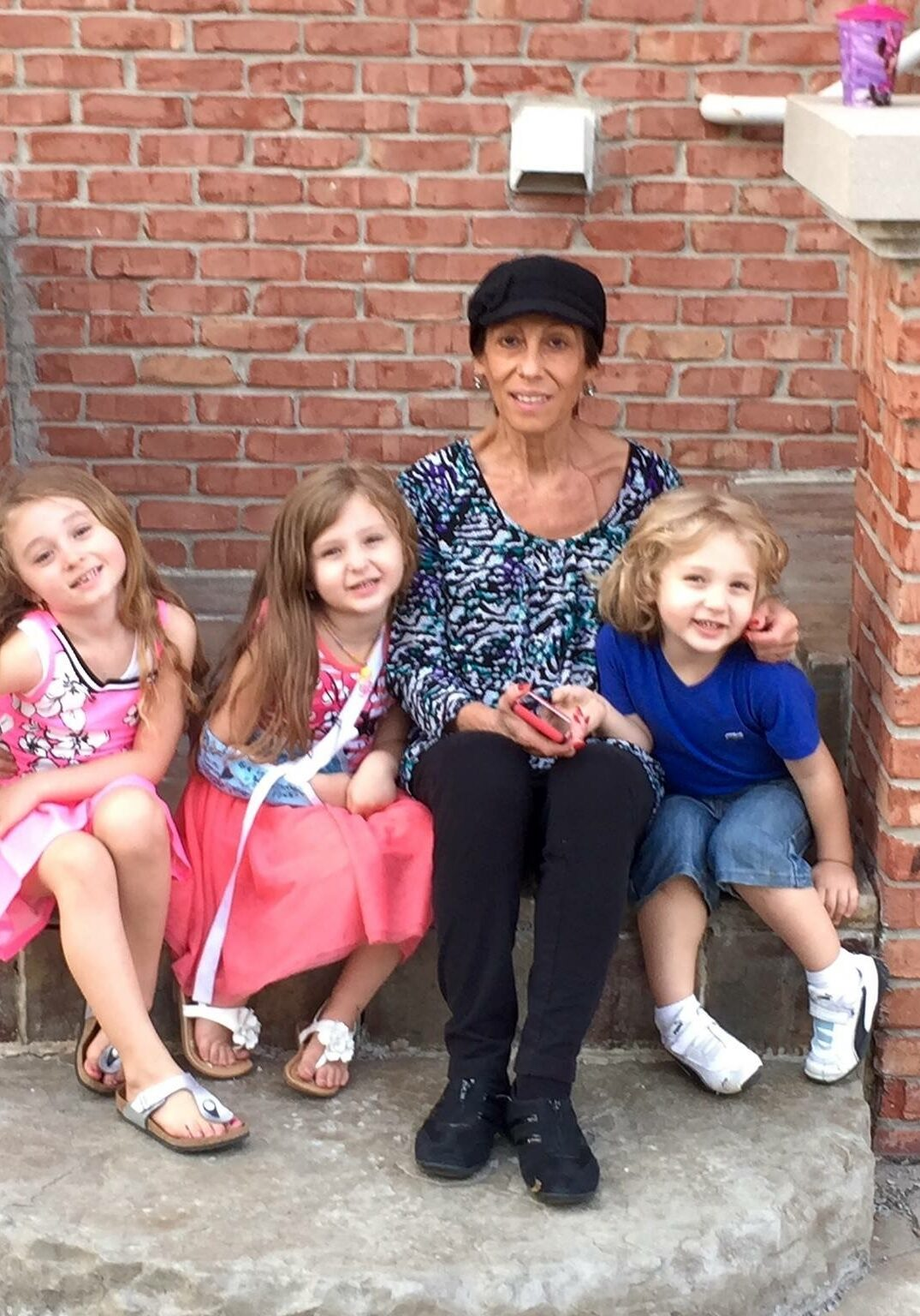 mom and kids on porch